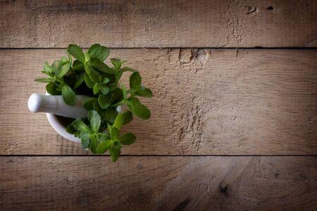 Alternative medicine herb , mortar, laboratory glassware, on a wooden background. 版權商用圖片