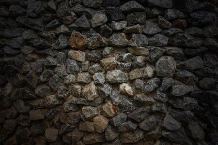 Small gravel, rock or stone on the floor or ground for background. Hard material.