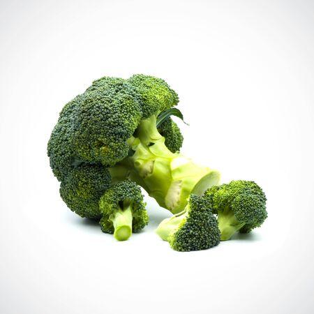 Broccoli separate pieces on the white blackground Foto de archivo