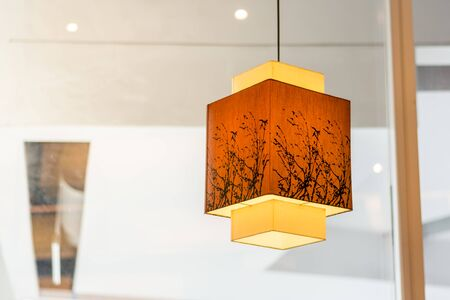 Close up japanese style hanging lamp decorated in restaurant.