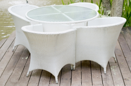 Woven white plastic chairs in the garden  Stock Photo - 21578469