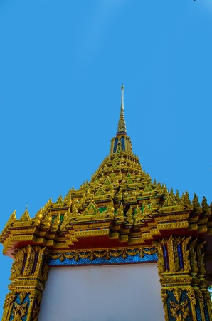 Traditional Thai architecture with blue sky photo