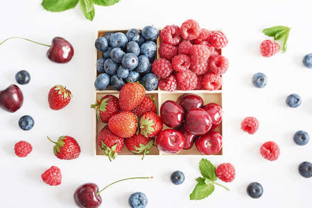 Fruit pattern of colorful fresh berries on white background. Top view. Flat lay. Summer Organic Berry Cherry, Currant, Gooseberry. Agriculture, Gardening, Harvest Concept. Vitamins, Healthy Diet.
