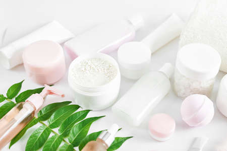 Mockup composition Natural cosmetics ingredients for skincare, body and hair care.Top view bottles with facial treatment product white background. Makeup Layout. Set of traditional spa products Banco de Imagens