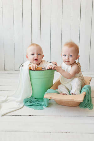 Children's Day. Sweet funny baby on bed in children room. Greeting card, copyspace for your text. Poster for spring and summer holiday. Congratulations on Mother's Day. Cute baby twin boys.