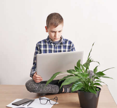 Online lesson at home, social distance during quarantine, self-isolation, online education concept, home schooler. Boy learning language online, using laptop, distance education. Student boy, school.