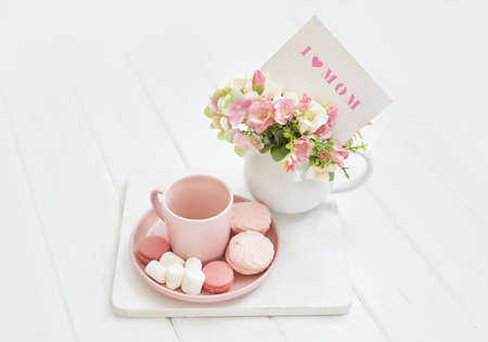 Mother's Day Greeting Card. Romantic breakfast. Happy mothers day frame background. Tea set with flowers and sweet. Spring card template. Happy Birthday or Valentine. Women's Day. Copy space
