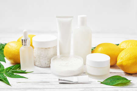 Natural organic homemade cosmetics with lemon. Skin care. Spa salon and treatments. Beautician background. Clay, lemon, beauty products, tropical summer concept. Flat lay, copy space.