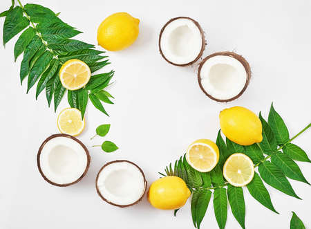 Natural organic homemade cosmetics with lemon and coconut. Skin care. Spa salon and treatments. Beautician background. Clay, lemon, beauty products, tropical summer concept. Flat lay, copy space.