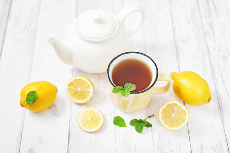 Tea with lemon. Cup of tea. Cozy morning. Healthy breakfast. Good morning. Health prevention. Vitamins. Citruses colds, copy space. Aromatherapy. Food mood. Food and drink, still life health care
