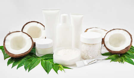 Natural organic homemade cosmetics with coconut. Skin care. Spa salon and treatments. Beautician background. Clay, lemon, beauty products, tropical summer concept. Flat lay, copy space. Coconut milk.