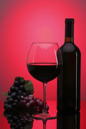 Glass of red wine and bottle with grape Stock Photo - 17731832