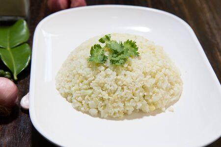 Cauliflower Rice on wood Background