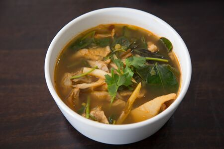 Hot and spicy pork bone with tamarind and Thai herbs soup on bowl