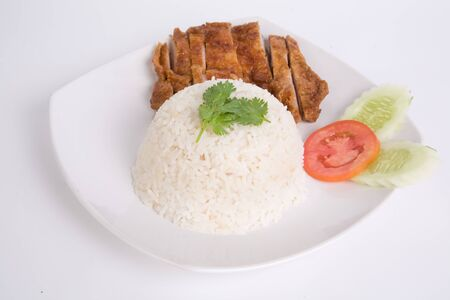 Vegetables and Grilled chicken breasts with thai jasmine rice in white dish isolated on white background. Thai style Food. Stock Photo