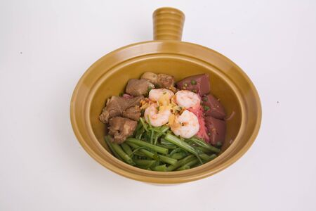 stir fried of pink seafood flat noodles on the white background.
