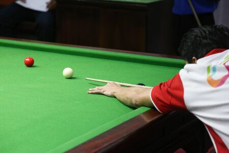 snooker ball on the green snooker table. Archivio Fotografico - 136902993