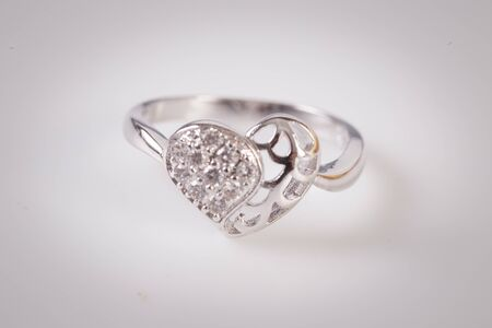 Close up of elegant diamond ring on the white background. Diamond ring.