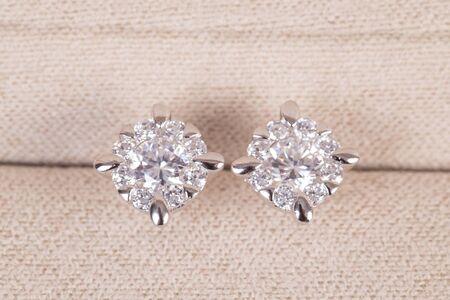 Silver earrings with diamonds macro shot. Standard-Bild