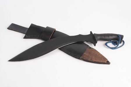 Small knife in leather case. Studio Photo