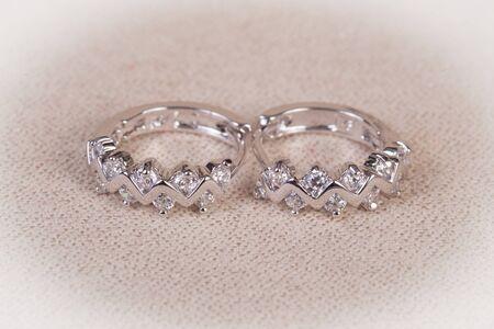 Silver earrings with diamonds macro shot.