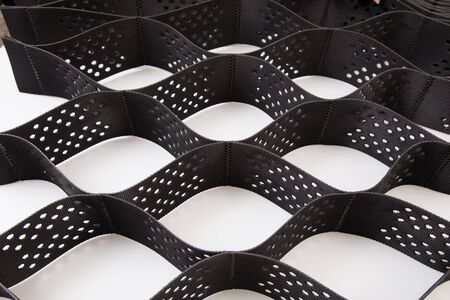 The design of the slope. Plastic black honeycomb frame filled