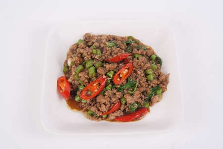 stir-fried with minced pork and basil on white plate