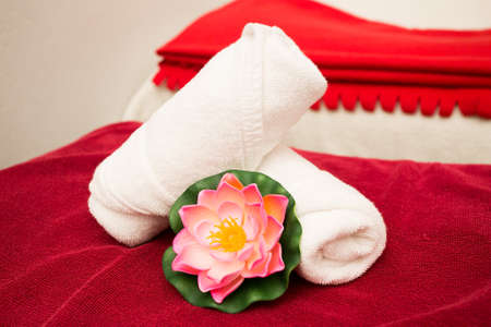 Clean towels on bed in spa room
