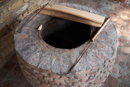 georgian: Traditional deep Georgian oven for bread baking
