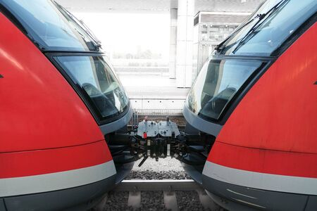 2 way: Two red train carriages at the station