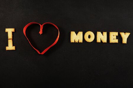 Text I heart money on black
