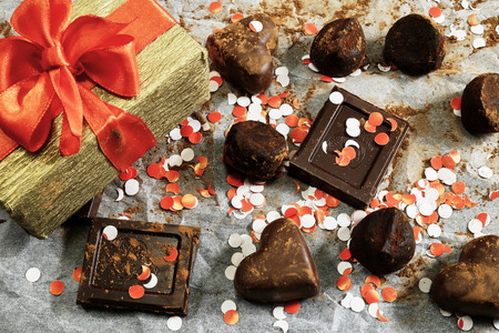 Assorted chocolate, gift box and confetti