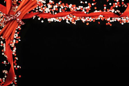 White and red confetti on blackboard Stock fotó