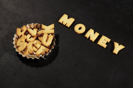 Assorted letters and word money on black