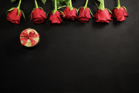 Red roses and gift box with copy space