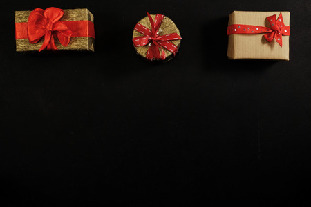 Blackboard copy space with gift boxes with red ribbon