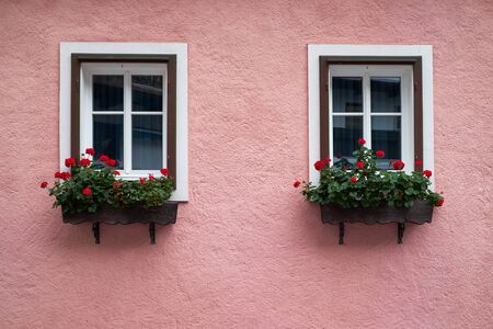 View of traditional Alps house with windows and flowers Stock fotó