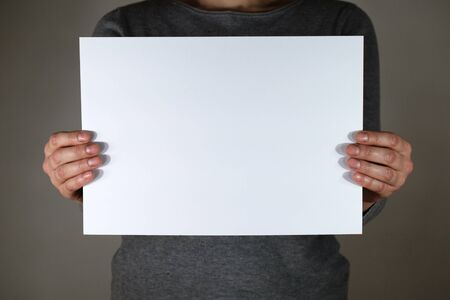 Two hands holding white sheet for copy space Stock fotó