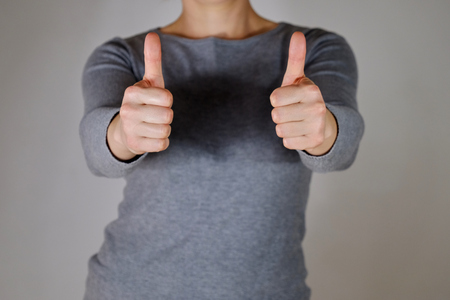 Woman holding two thumbs up