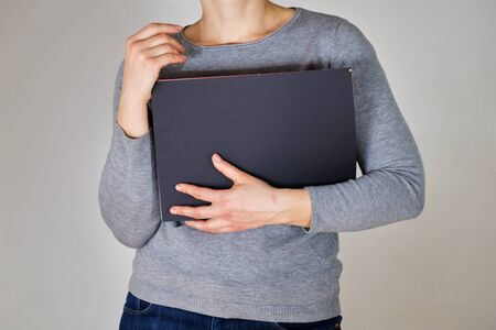Woman holding grey folder with papers Stock fotó