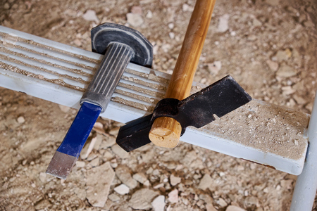 Hammer and chisel on ladder and rubble Stock fotó - 81603125