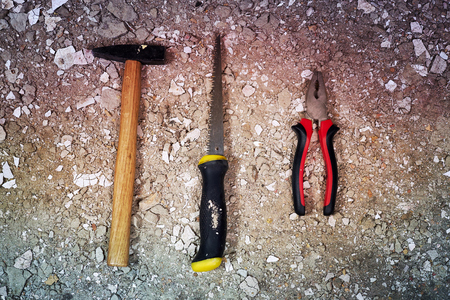 Hammer, saw and pliers on rubble Stock fotó