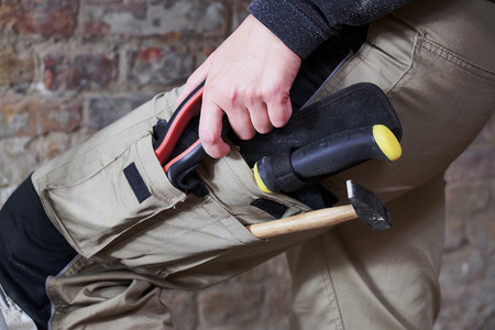 Worker wearing work pants with tools in pockets Stock fotó - 81361106