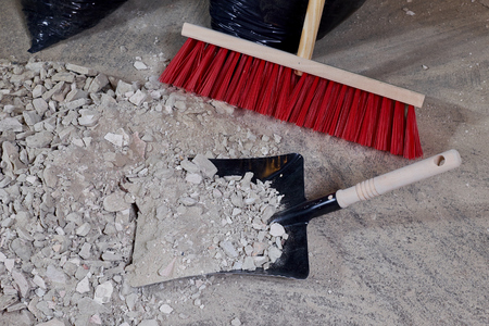 Broom and dustpan on a pile of construction rubble Stock fotó - 81776515