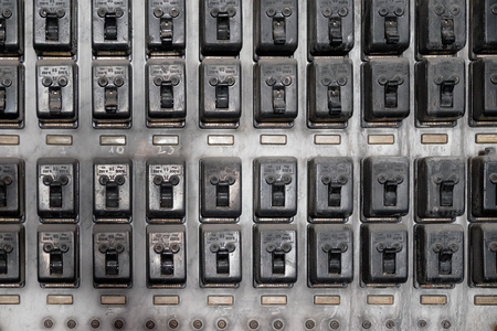 Old electric switches in defunct power station