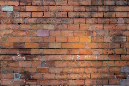 Orange yellow brick wall background Stock fotó - 129074653