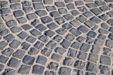 Cobbled stone pavement in grey colours Stock fotó