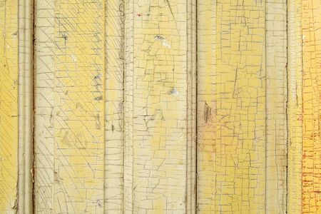 Wood boards with cracked old paint background