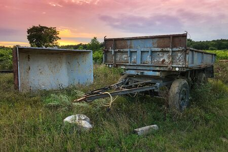 Old abandoned agricultural machines in the field