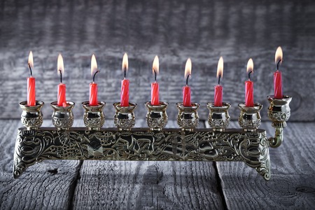 gelt: The Symbols of Hanukkah - nine-branched mehorah Hanukiah Stock Photo